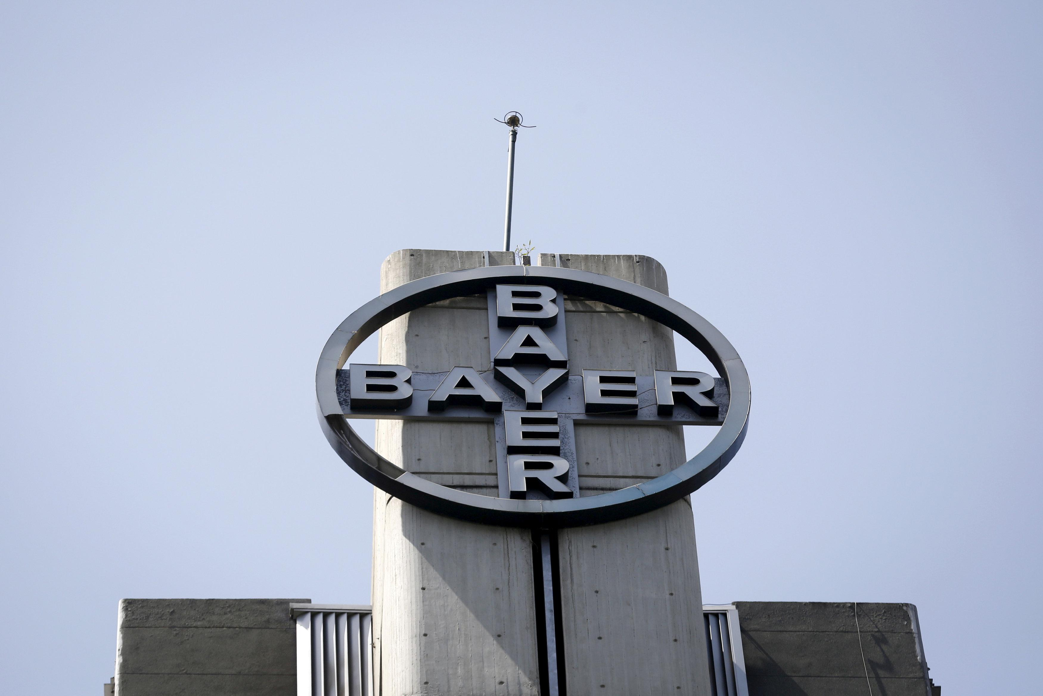 The corporate logo of Bayer is seen at the headquarters building in Caracas May 6, 2015. Carlos Garcia Rawlins