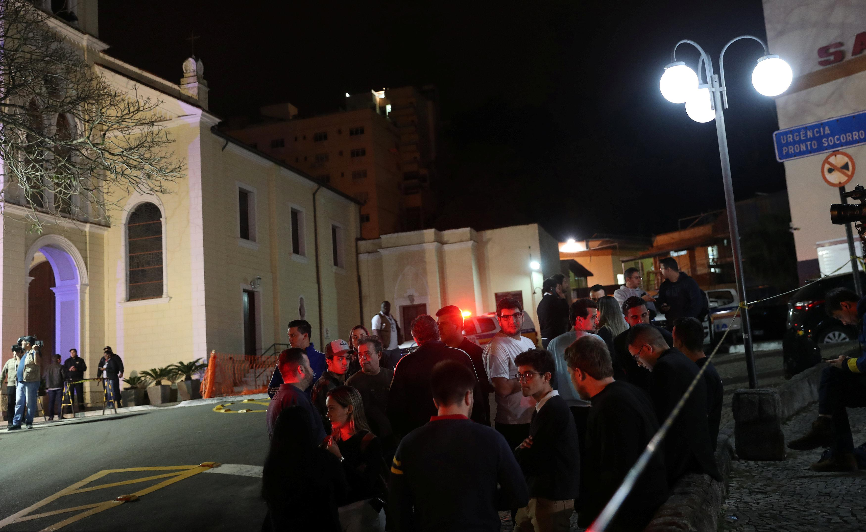 Supporters of presidential candidate Jair Bolsonaro are pictured outside the Santa Casa hospital where he was hospitalized after being stabbed in Juiz de Fora, Brazil September 6, 2018. Ricardo Moraes