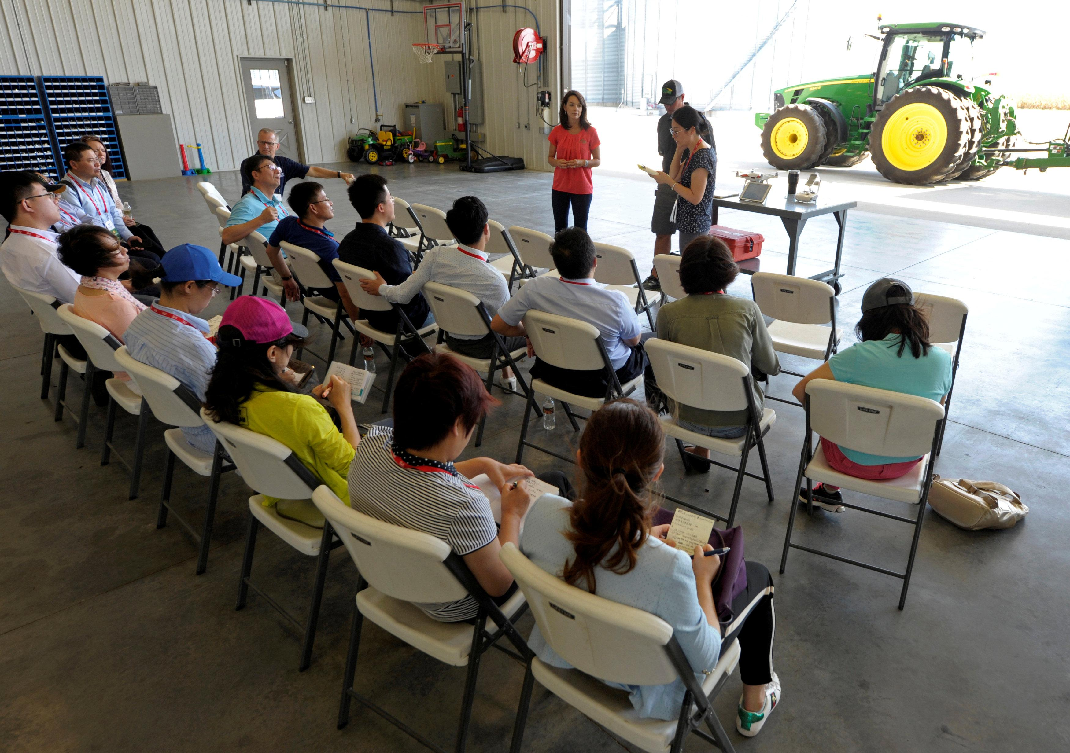 A Chinese trade delegation listens about modern farming during a visit to the Kaiser farm near Norborne, Missouri, U.S., August 28, 2018.  Dave Kaup