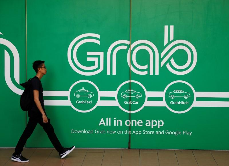 Singapore fines Grab and Uber, imposes measures to open up