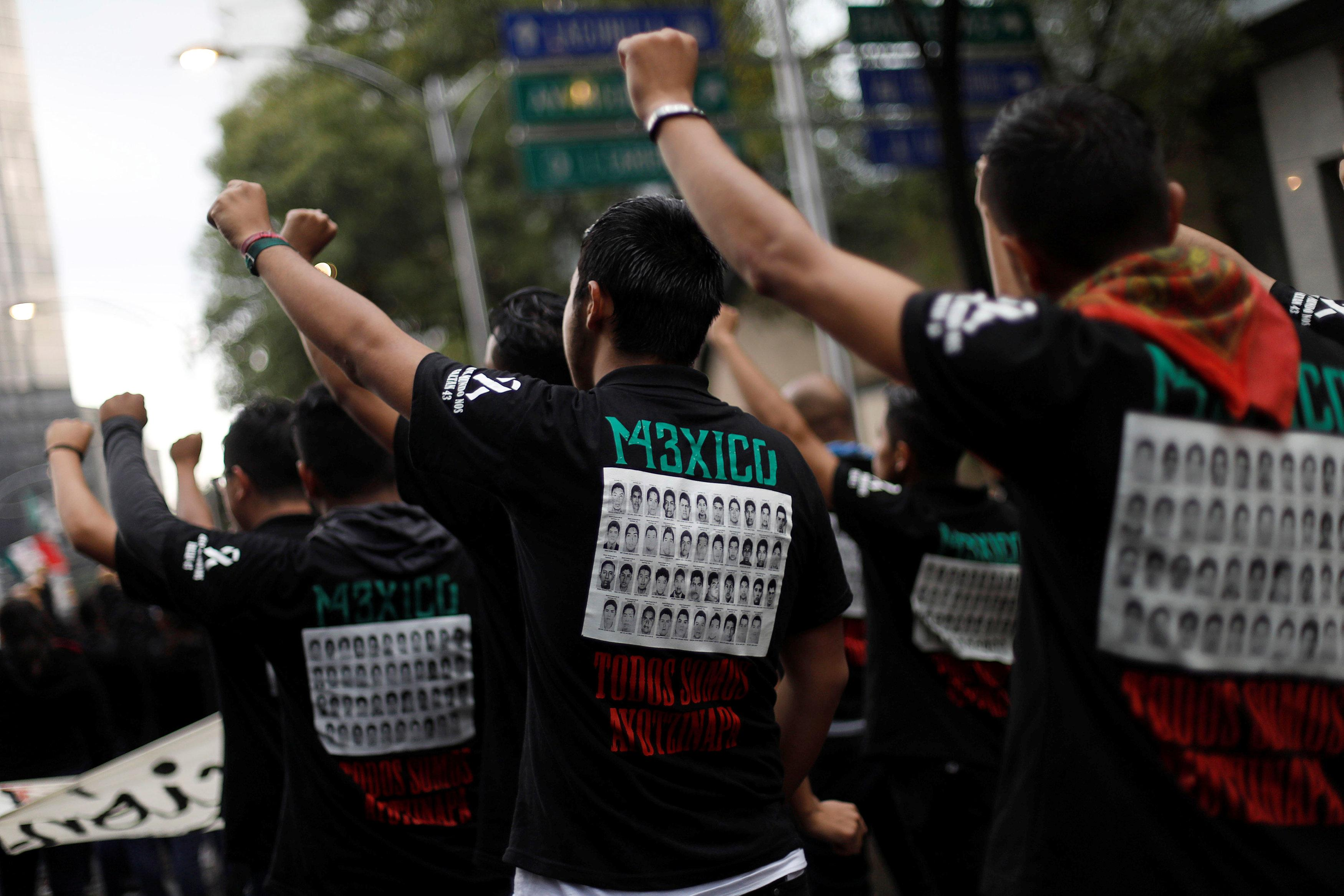 Demonstrators gestures during a march to mark the fourth year since the disappearance of the 43 students of training college Raul Isidro Burgos in the state of Guerrero, in Mexico City, Mexico September 26, 2018. Edgard Garrido
