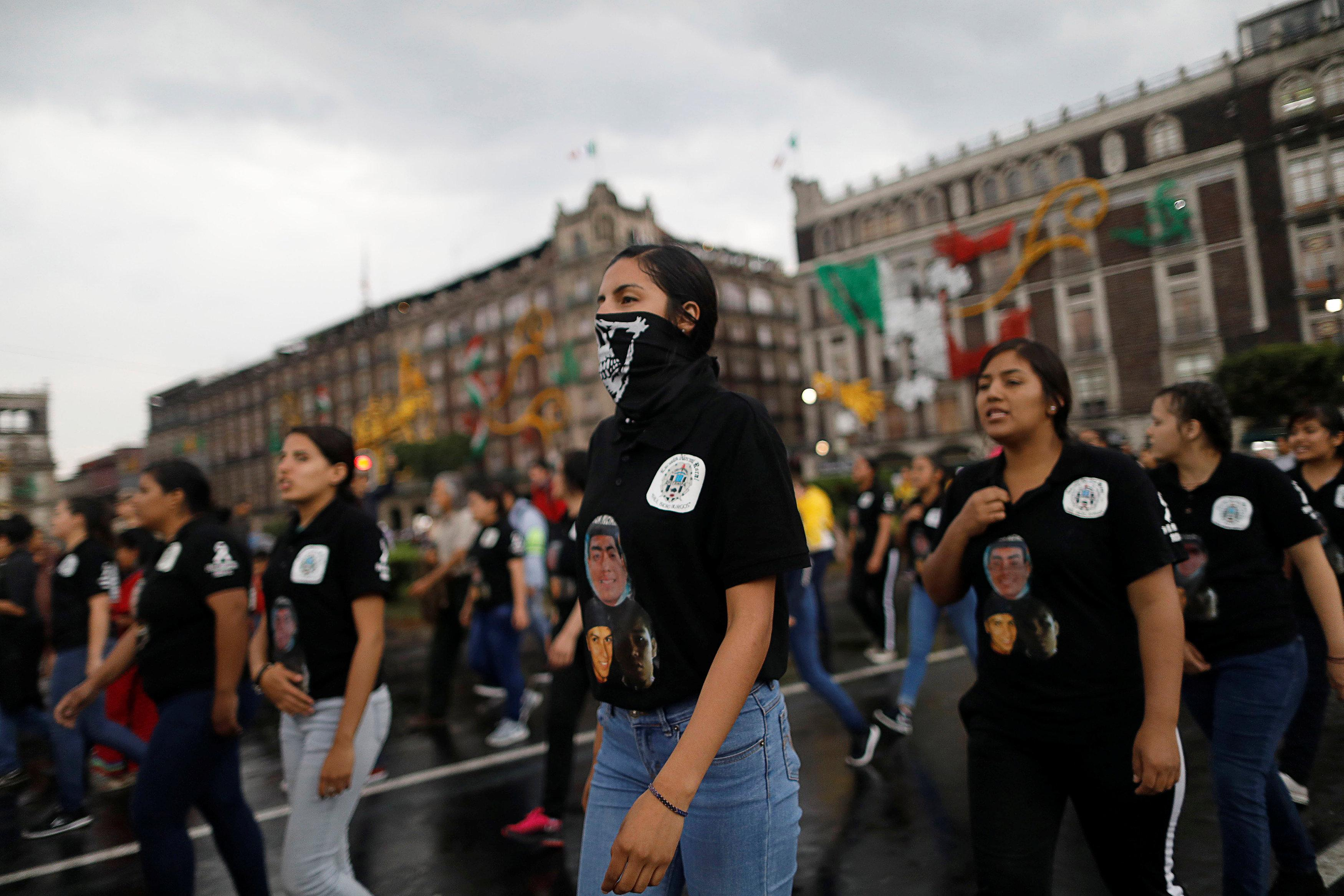 Demonstrators take part during a march to mark the fourth year since the disappearance of the 43 students of training college Raul Isidro Burgos in the state of Guerrero, in Mexico City, Mexico September 26, 2018. Edgard Garrido