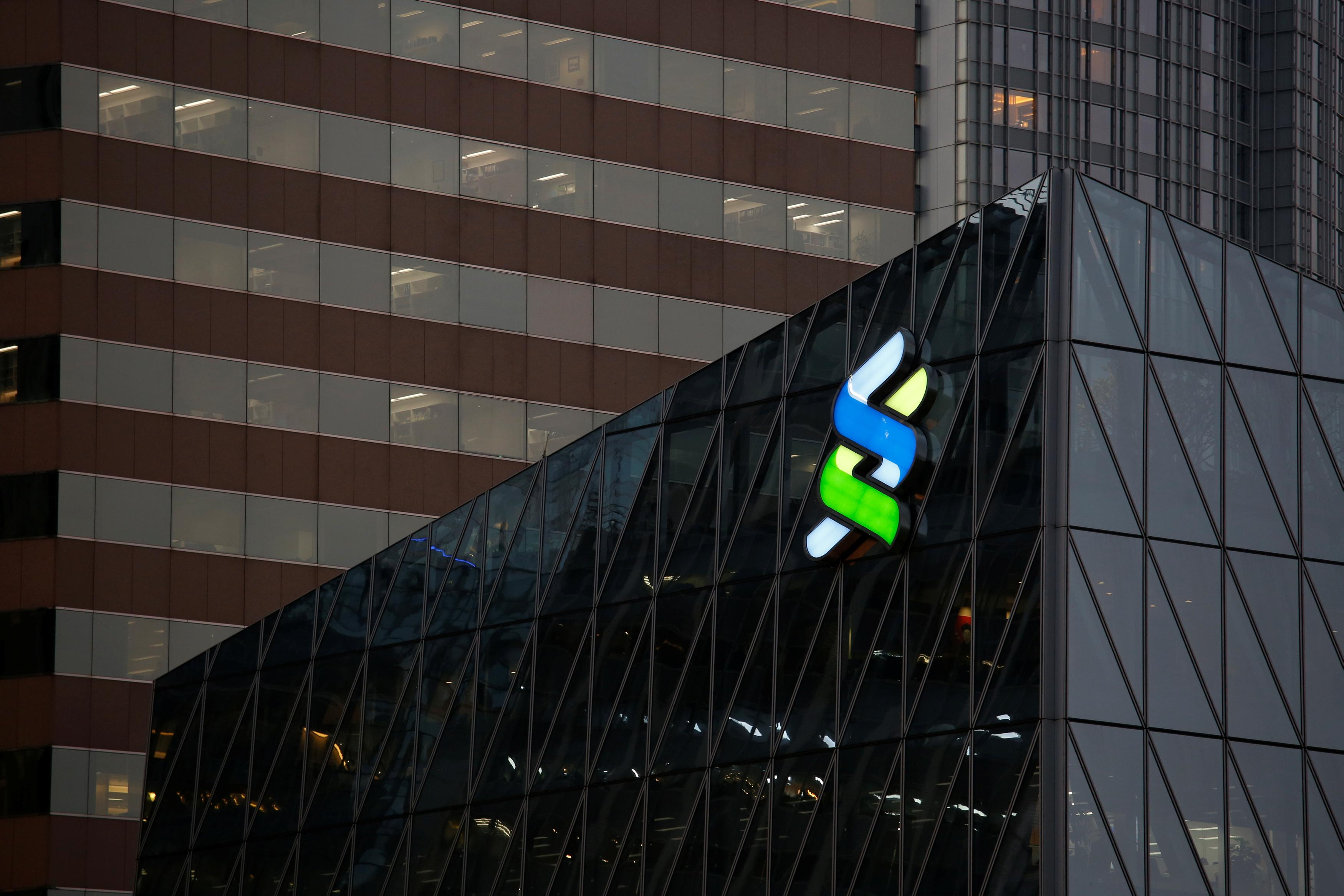 A logo of Standard Chartered is displayed at the financial Central district in Hong Kong, China November 23, 2017.      Bobby Yip