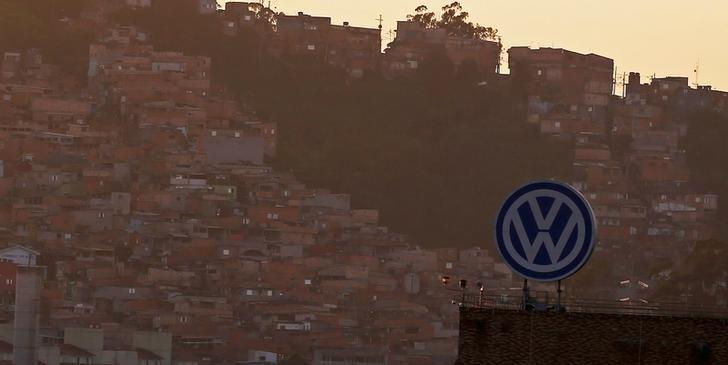 A Volkswagen logo is pictured in front of a slum, at the Volkswagen plant in Sao Bernardo do Campo, near Sao Paulo January 8, 2015.  Nacho Doce/File photo