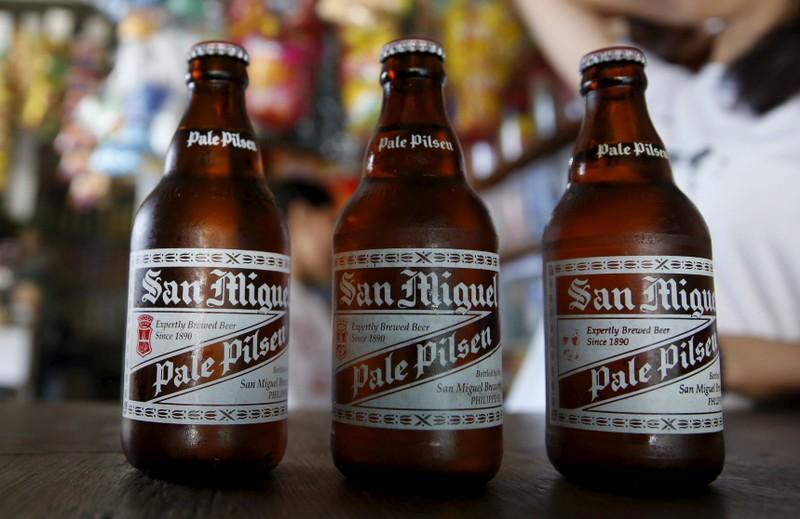 Philippines' San Miguel halves food unit's share sale to $920