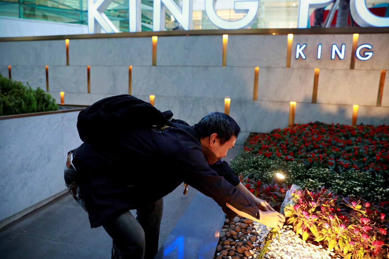b8db5ae17677bd A man lays flowers in front of King Power's head office, after the  company's owner Vichai Srivaddhanaprabha and four other people died in a  helicopter crash ...