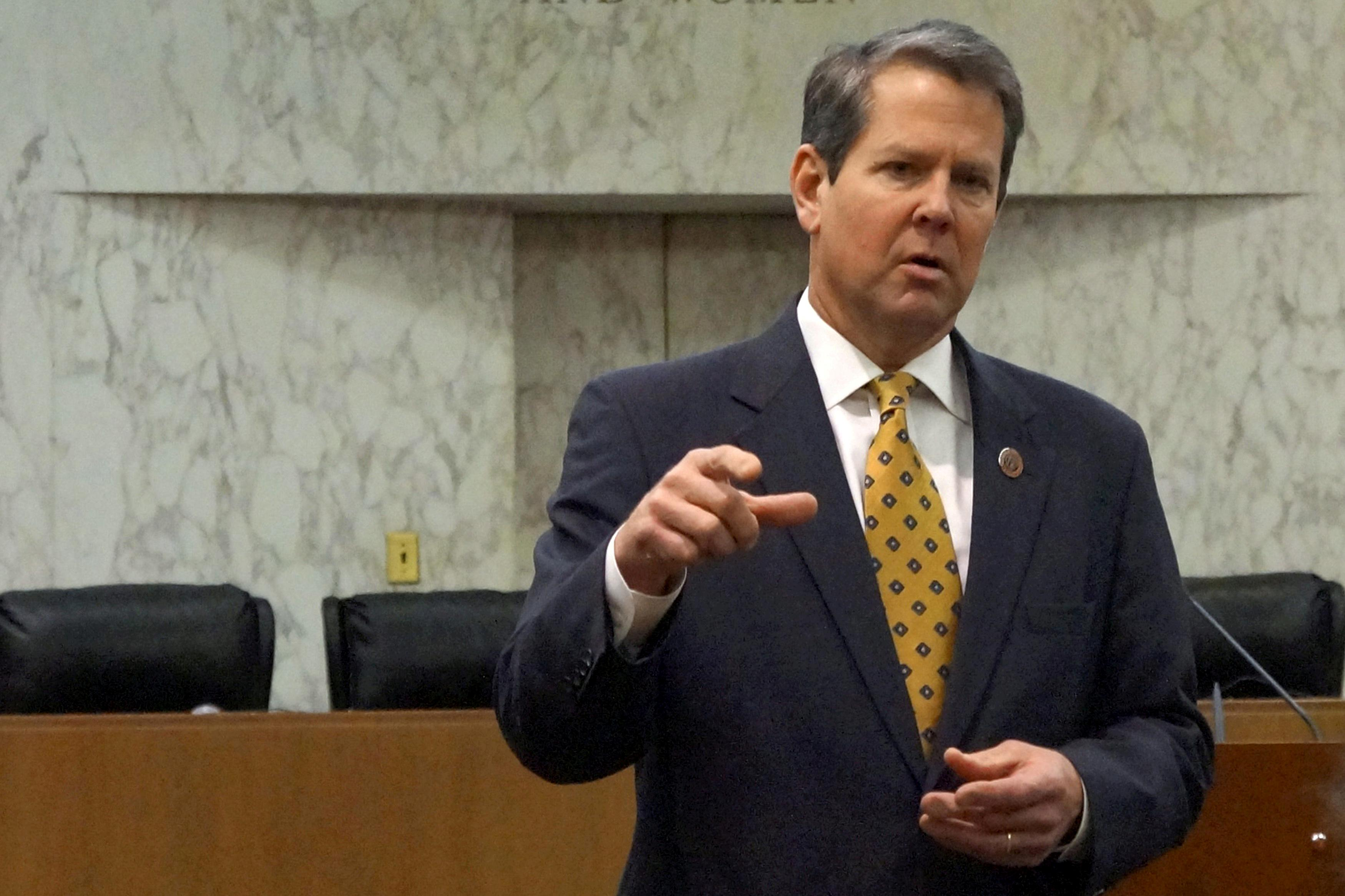 "Georgia Secretary of State Brian Kemp speaks with visitors to the state capitol about the ""SEC primary"" involving a group of southern states voting next month in Atlanta, Georgia, U.S., February 24, 2016. Letitia Stein"