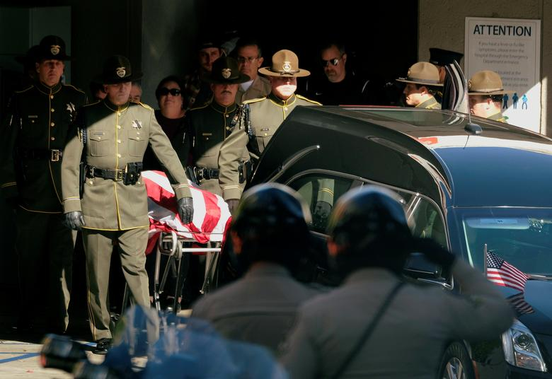 The body of Ventura County Sheriff Sgt. Ron Helus, who was shot and killed in a mass shooting at a bar is transferred to a hearse for procession from the Los Robles Medical Center in Thousand Oaks, California. REUTERS/Ringo Chiu