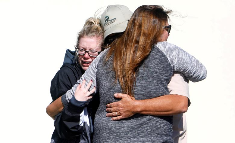 Mourners react outside a reception center for families of victims of a mass shooting in Thousand Oaks, California, November 8, 2018. REUTERS/Eric Thayer