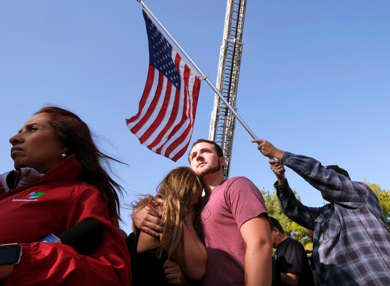 People attend the procession for the Ventura County Sheriff Sgt. Ron Helus, who was shot and killed in a mass shooting at a bar in Thousand Oaks, California. REUTERS/Ringo Chiu