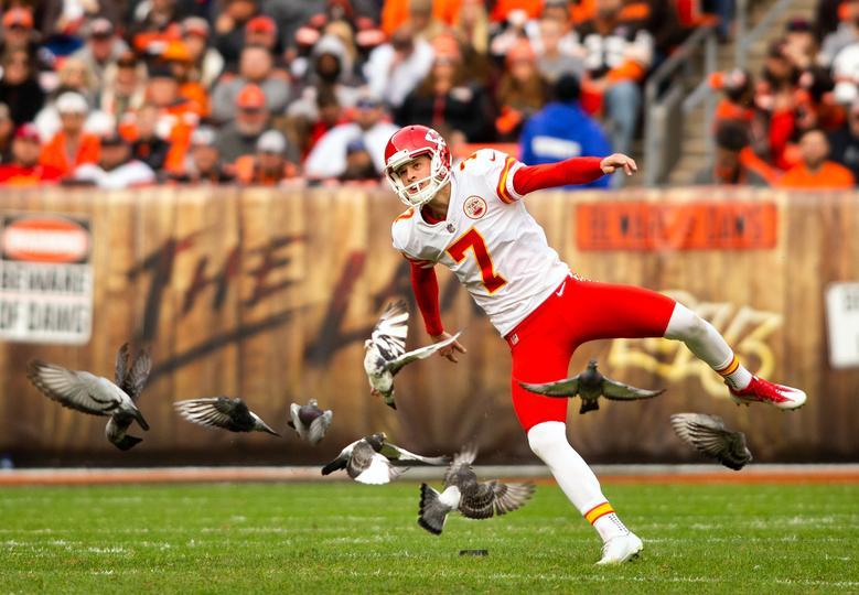 3d31d68508c A flock of pigeons fly away as Kansas City Chiefs kicker Harrison Butker  kicks the ball