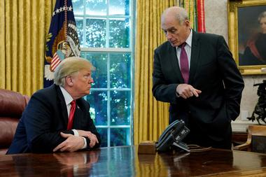 FILE PHOTO: U.S. President Trump speaks to Chief of Staff Kelly after an...