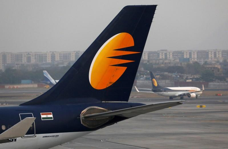 A Jet Airways plane is parked as other moves to runway at the Chhatrapati Shivaji International airport in Mumbai, India, February 14, 2018. Danish Siddiqui