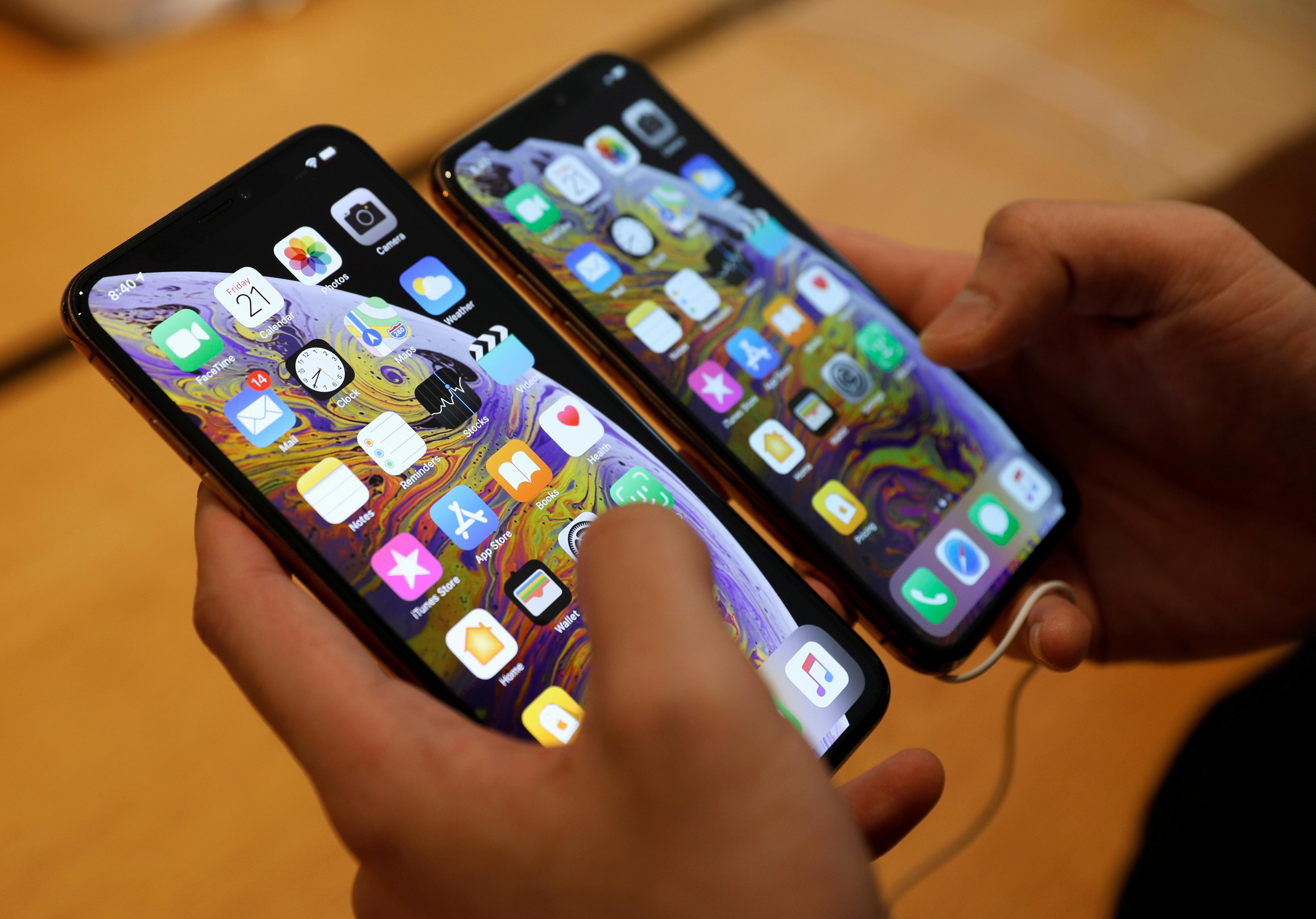 apple cuts production orders for all three new iphone models wsj