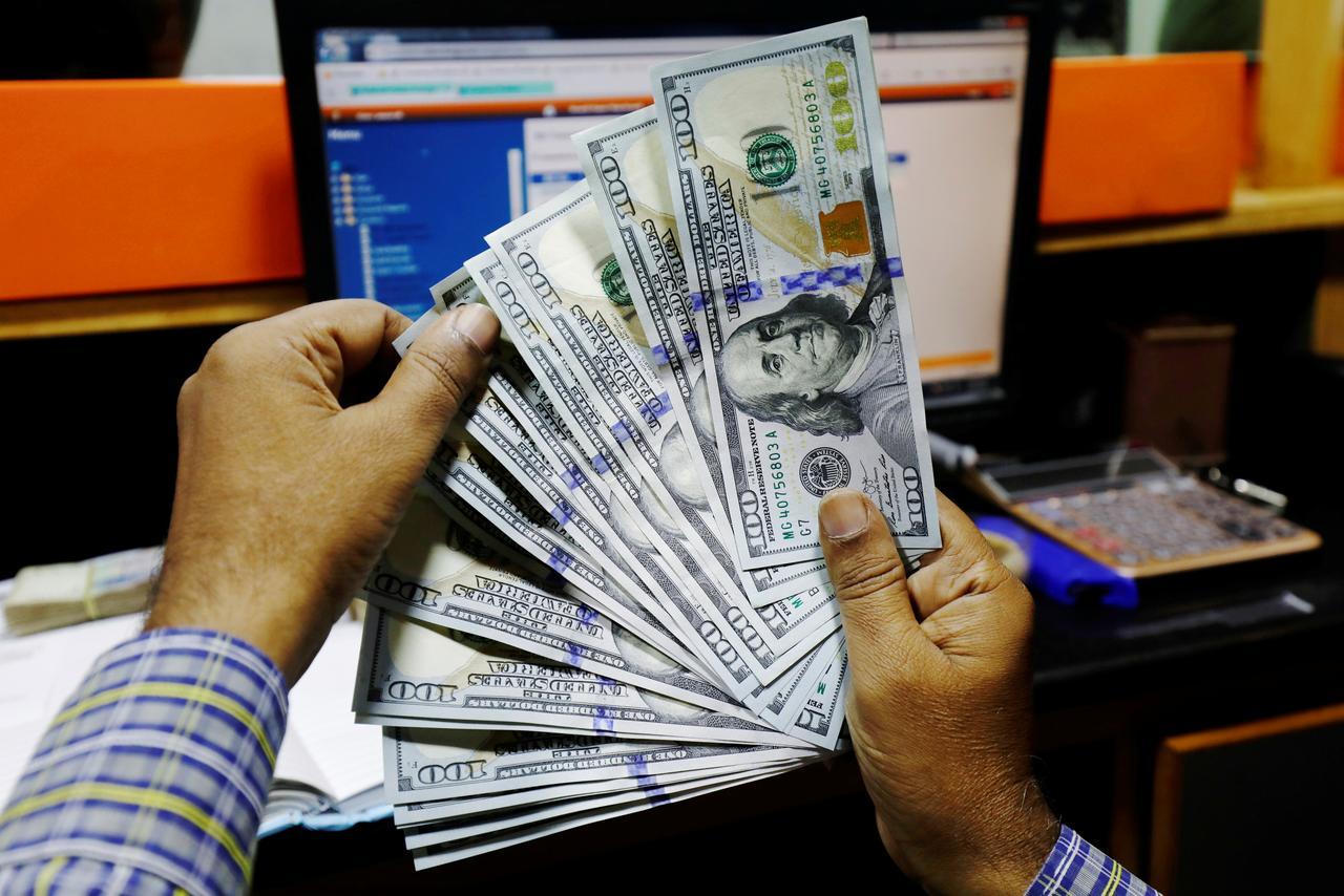 A Trader Shows U S Dollar Notes At Currency Exchange Booth In Karachi Stan December 3 2018 Reuters Akhtar Soomro