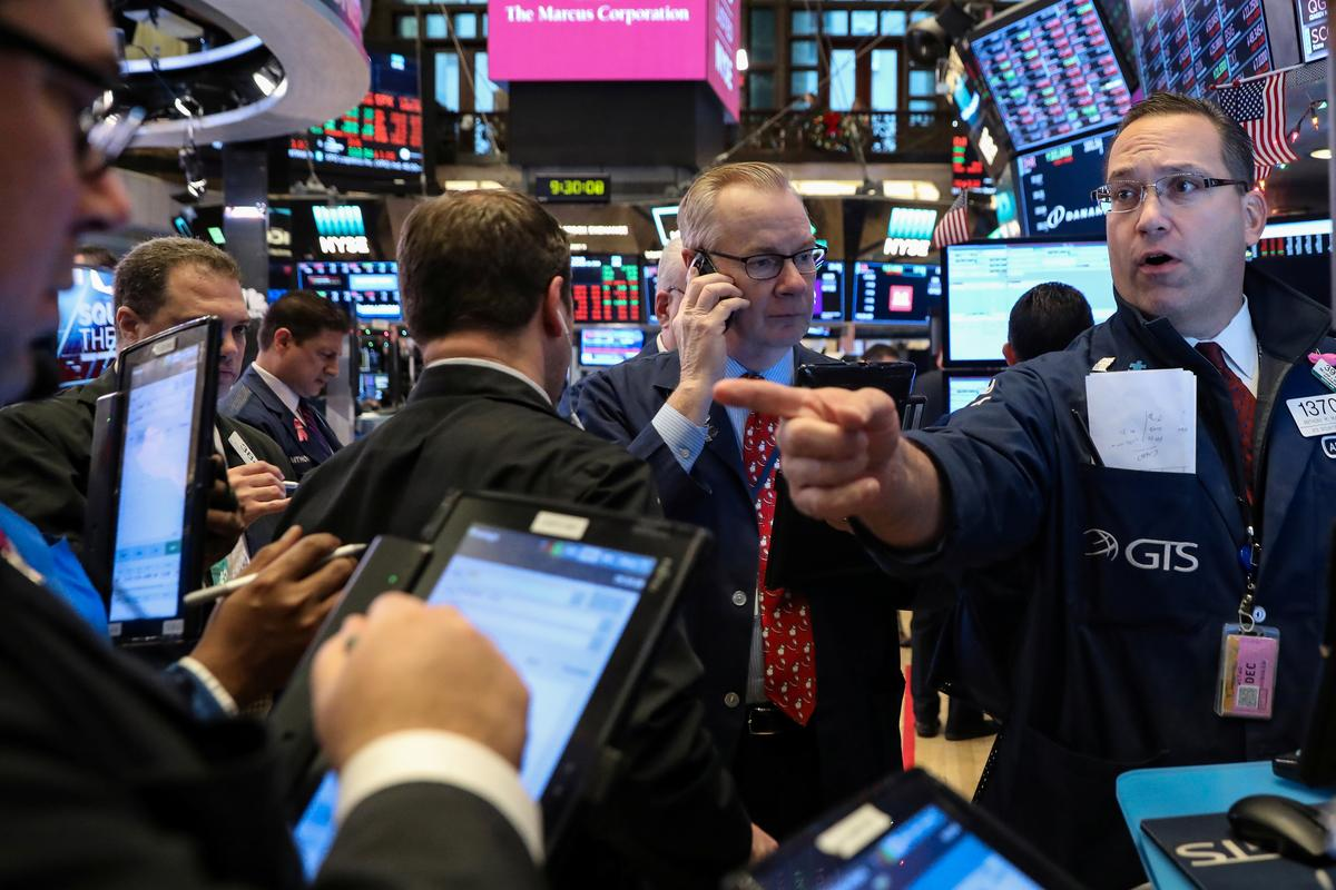 Wall Street opens lower as growth concerns linger; Fed in focus