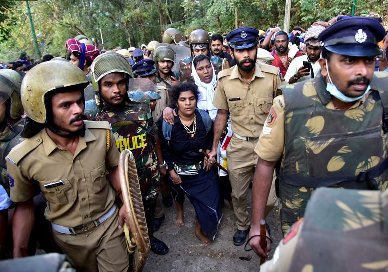 Bindu Ammini, 42, and Kanaka Durga, 44, are escorted by police after a failed attempt to enter the Sabarimala temple in Pathanamthitta district in the southern state of Kerala, India, December 24.    REUTERS/Stringer