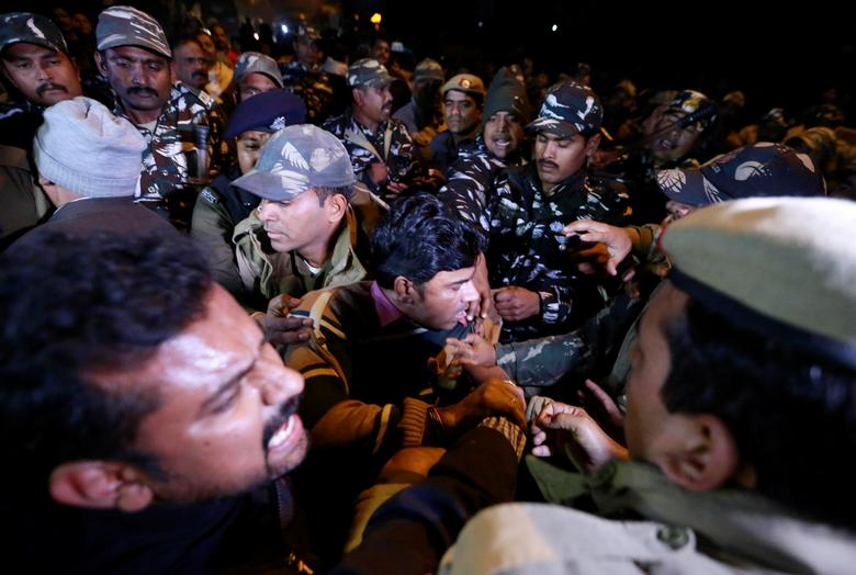 Protesters scuffle with police during a protest against state government for allowing two women to defy an ancient ban and enter the Sabarimala temple, in New Delhi, January 3. REUTERS/Adnan Abidi