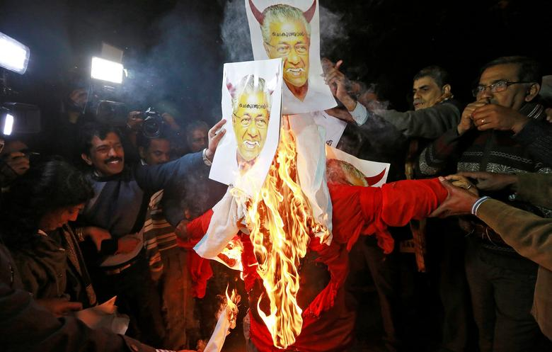 Protesters burn an effigy of Pinarayi Vijayan, Chief Minister of the southern state of Kerala, during a protest against state government for allowing two women to defy an ancient ban and enter the Sabarimala temple, in New Delhi, January 3. Conservative Hindu groups forced India's southern state of Kerala to a standstill on Thursday as they protested against the state government for allowing two women to defy an ancient ban and enter a Hindu temple.      REUTERS/Adnan Abidi