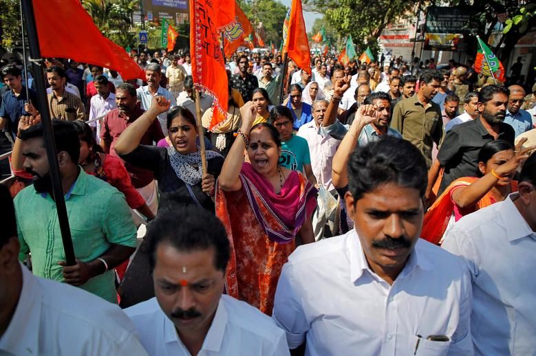 Supporters of India's ruling Bharatiya Janata Party (BJP) and Hindu nationalist organisation Rashtriya Swayamsevak Sangh (RSS) attend a protest rally during a strike against the state government for allowing two women to defy an ancient ban and enter the Sabarimala temple, in Kochi, India, January 3. REUTERS/Sivaram V