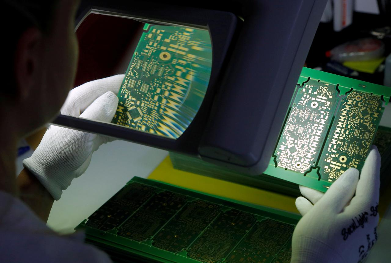 Austrias Ats Cuts Sales Forecast On Weak Demand For Phones Cars Cutting Circuit Boards Images Of 2 Min Read File Photo A Worker Checks Printed