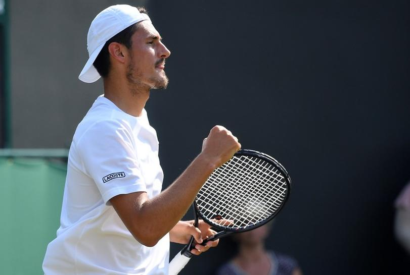 Tennis: Trick-shot Tomic bamboozles Kyrgios with bizarre match point