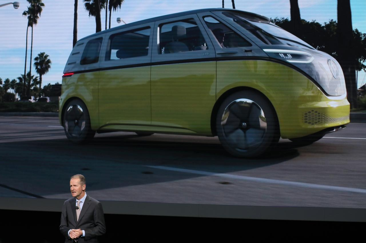 Dr Herbert Ss Ceo Volkswagen Ag Speaks In Front Of An Image A Van Concept Vehicle During The Company S Presentation At North American