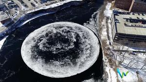 Massive circle of ice spins in Maine river