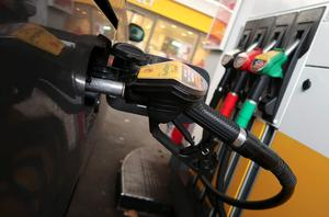 A diesel fuel nozzle is seen attached to a car at a Shell petrol station in...