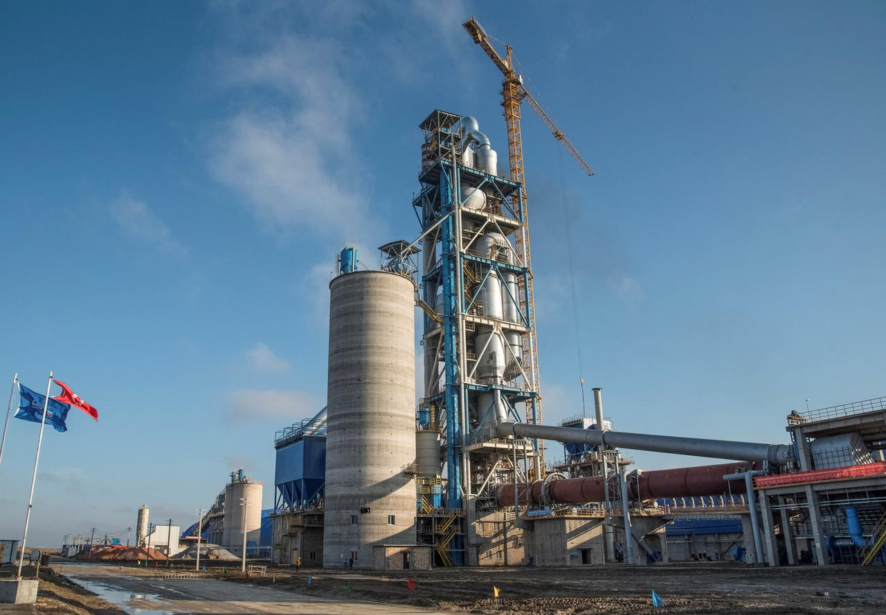 Shuttered at home, cement plants bloom along China's new Silk Road