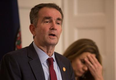 Virginia governor appears at funeral as pressure grows on his No. 2