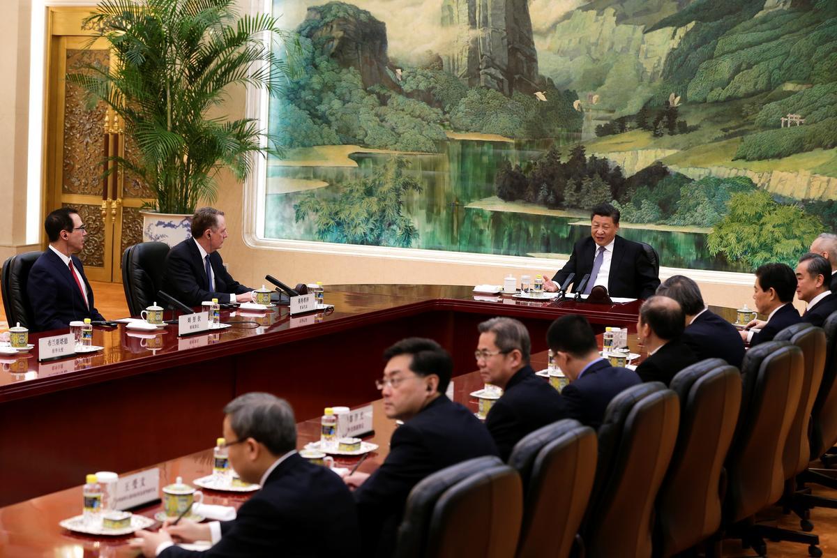 China's President Xi meets top U.S. trade delegation officials