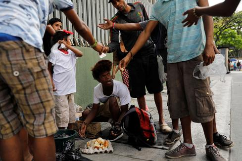 Warding off hunger, Venezuelans find meals in garbage bins