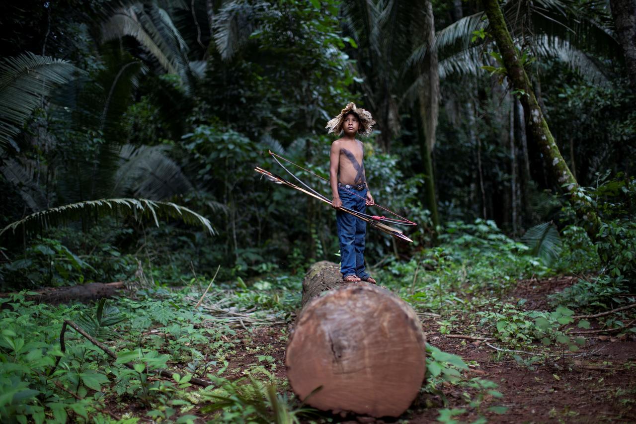 Image result for Emboldened by Bolsonaro, armed invaders encroach on Brazil's tribal lands