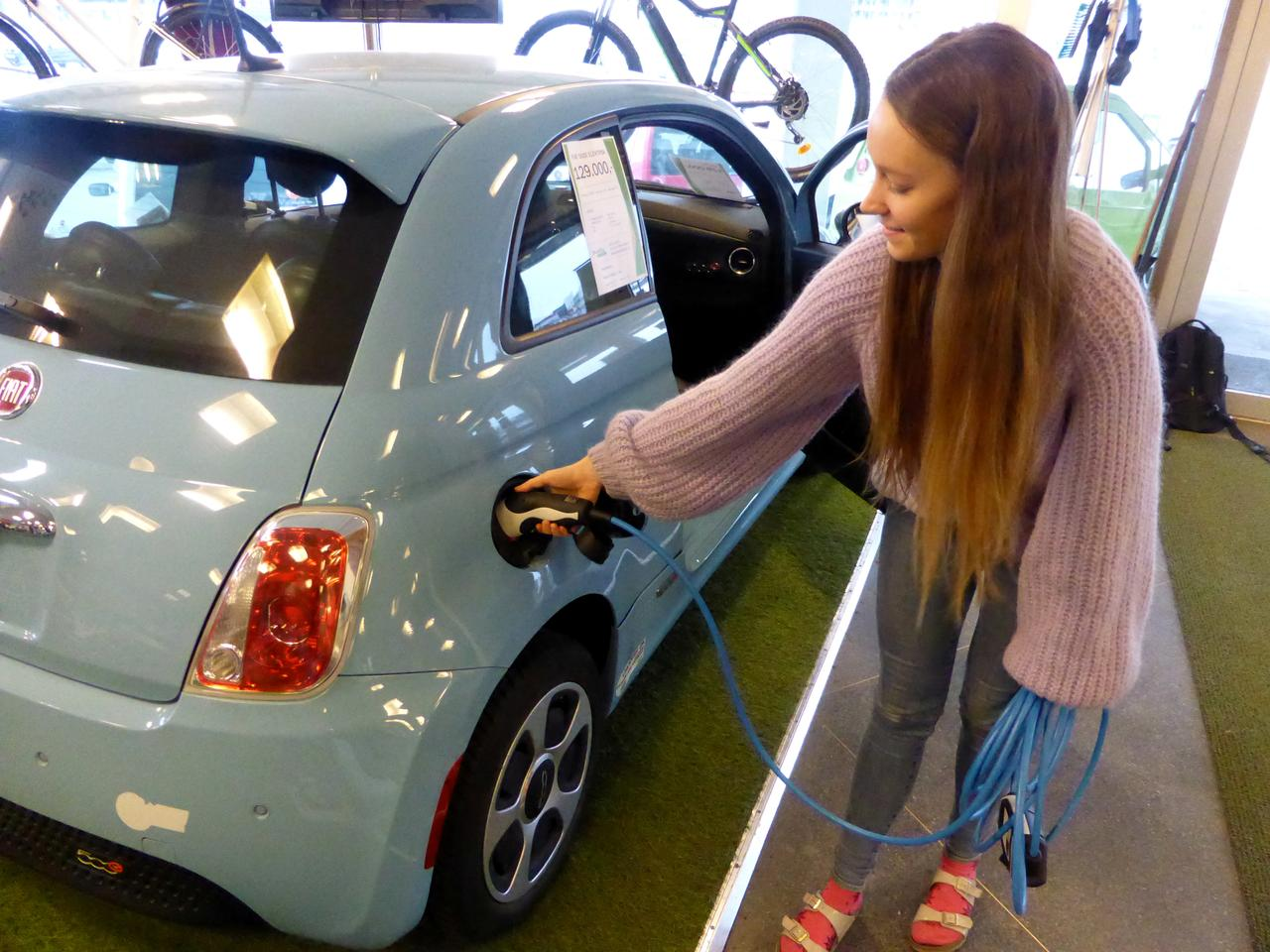 Maiken Skram Of Buddy Electric Car Dealer Company Shows The Charging A Second Hand Fiat 500e Imported From California U S In Oslo Norway March 15