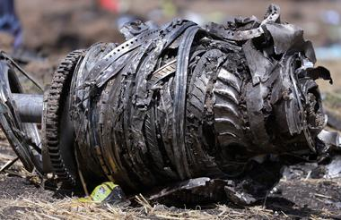FILE PHOTO: Airplane engine parts are seen at the scene of the Ethiopian...