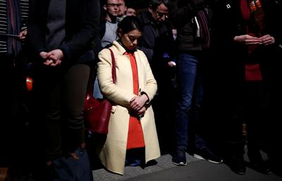 Stunned onlookers watch as Notre-Dame burns