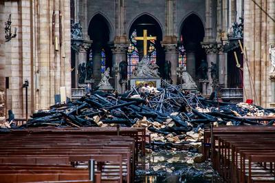 Notre-Dame smolders the morning after blaze