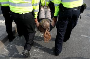 Hundreds arrested in London climate-change protests