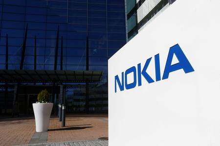 Nokia reports surprise first quarter loss, sees pressure in second half