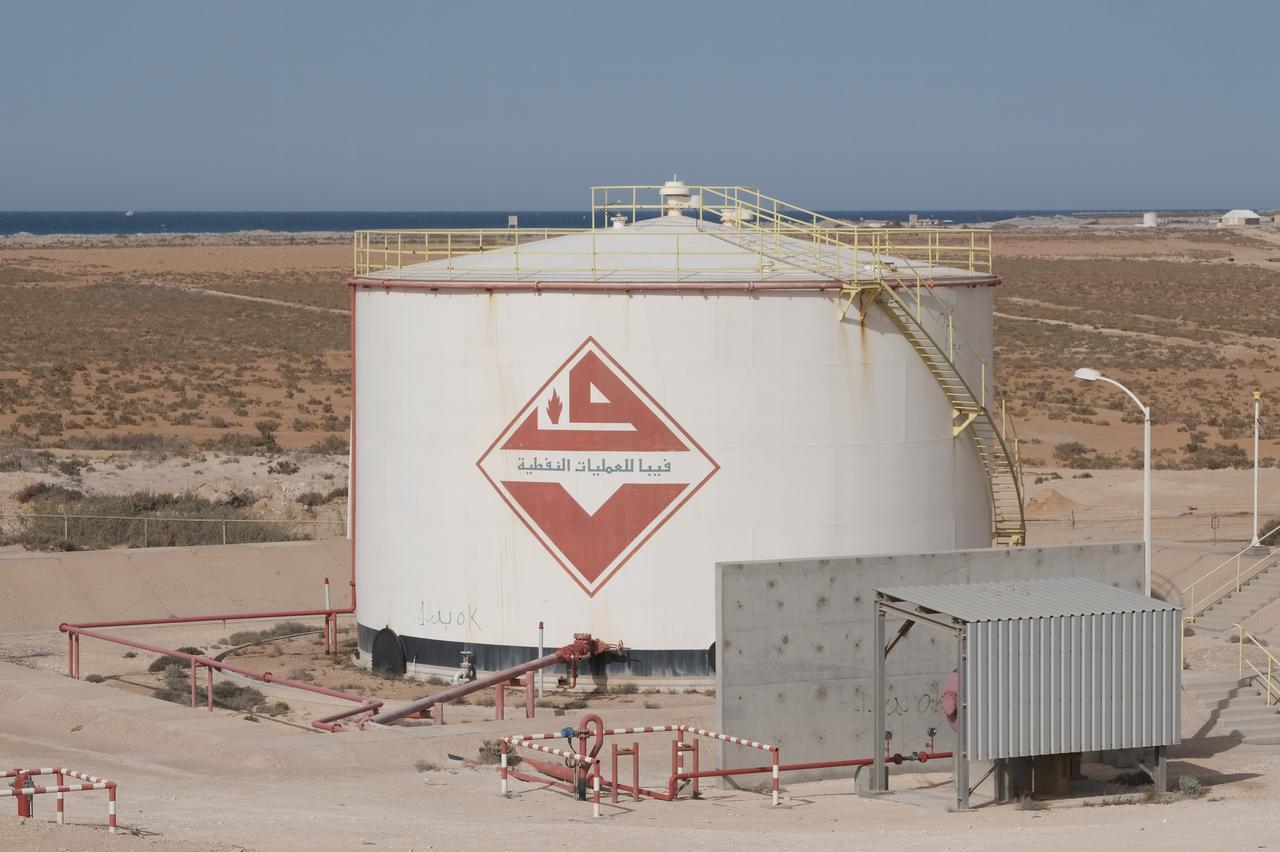 Air strike hits Tripoli as eastern Libyan forces send warship to oil