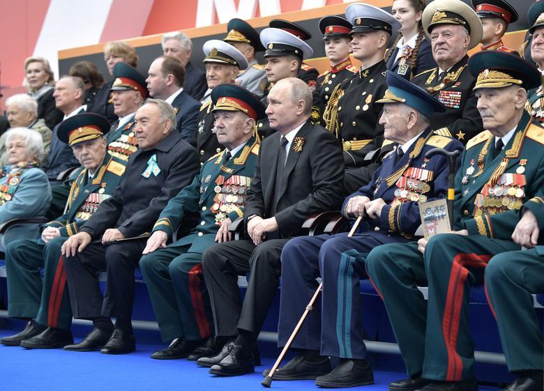Spectators, including Russia's President Vladimir Putin and Kazakhstan's Former President Nursultan Nazarbayev, attend the Victory Day parade in Red Square in central Moscow, Russia. Sputnik/Alexei Nikolsky/Kremlin via REUTERS