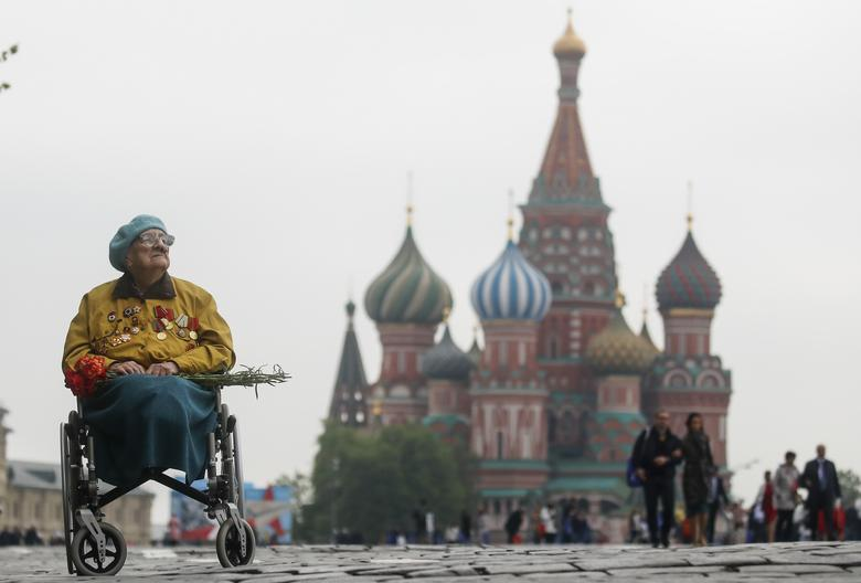 A veteran sits in a wheelchair in front of St. Basil's Cathedral after the Victory Day parade in Red Square in central Moscow, Russia. REUTERS/Maxim Shemetov