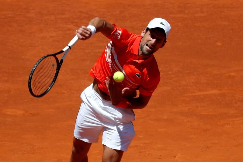 Tennis: Djokovic in Madrid Open semis after Cilic food poisoning withdrawal