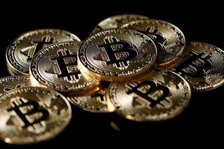Bitcoin extends losses, down more than 20% to below $6,300