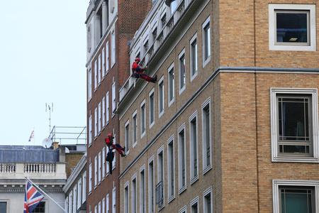 Greenpeace activists block BP London HQ demanding end to oil exploration