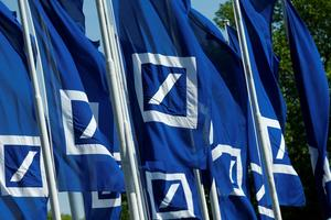 Flags with the logo of Deutsche Bank are seen at the headquarters ahead of...