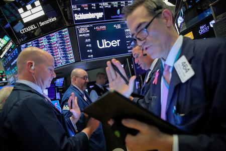 Uber's IPO underwriters recommend buying, estimate deep losses
