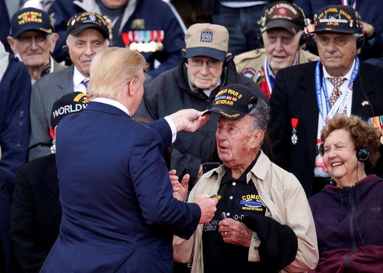U.S President Donald Trump greets WWII veterans during a ceremony to mark the 75th anniversary of D-Day at the Normandy American Cemetery and Memorial in Colleville-sur-Mer, France.   REUTERS/Christian Hartmann