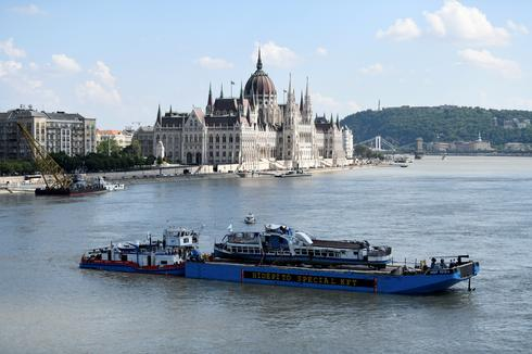 Capsized tourist boat recovered from Danube